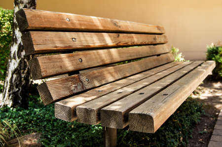 garden furniture: An old wooden bench at the park