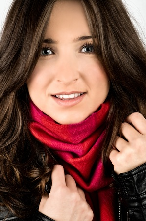 jacked: young woman wearing black jacked and red scarf looking straight Stock Photo