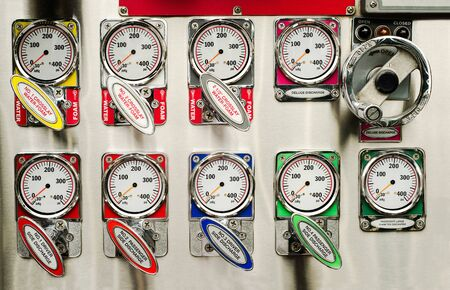 firetruck: pump panel and discharge gauges and piston valve