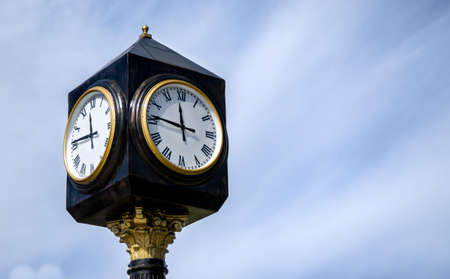 a vintege street clock on a poll Stock Photo - 13763613