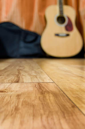 wooden floors: acoustic quitar in a room with wooden floor