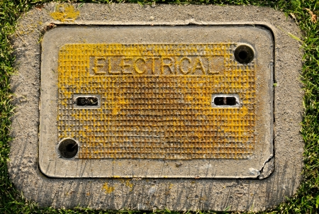 utility: an yellow electrical box in the ground
