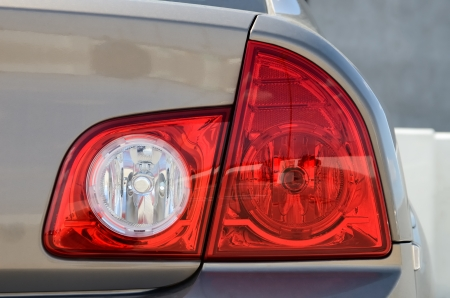taillight: taillight of a modern silver car in parking Stock Photo
