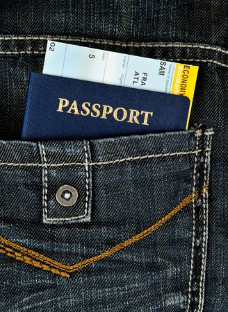 cloth back: US pasport with boarding pass in black jeans Stock Photo