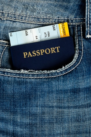 pasport with boarding pass in blue jeans Stock Photo