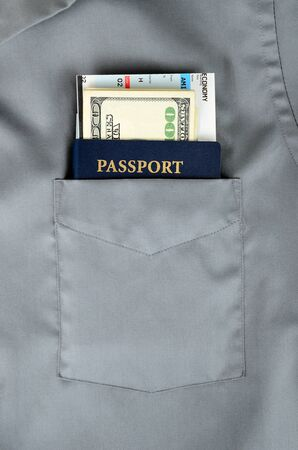american passport with money and boarding pass in a front pocket of a shirt Stock Photo