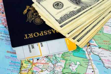 Passport book and tickets on a map and money photo