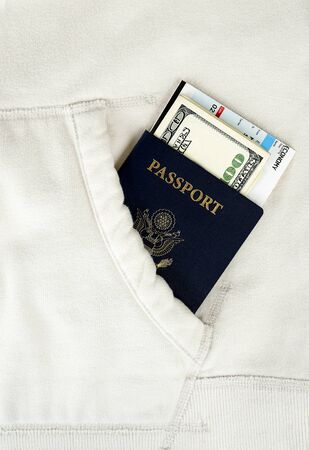 a us passports with boarding pass and money in white pocket