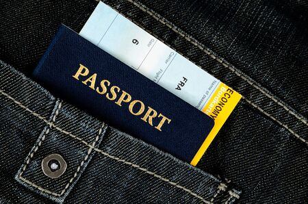 pasport  in black jeans, close up photo