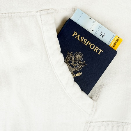 US passport with boarding pass in white pocket Stock Photo