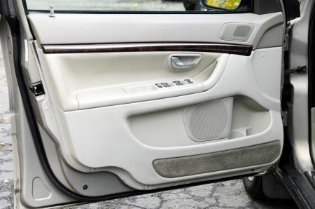 an open modern gray car door photo