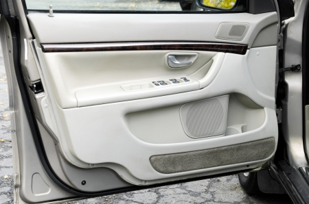 open car door: an open modern gray car door