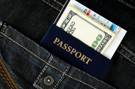 passport with boarding pass and money in black jeans Stock Photo