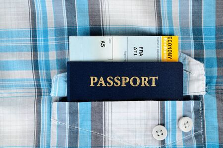 passport and boarding pass in a pocket photo