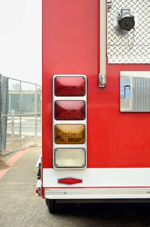 rear end: rear end of red firetruck on the street