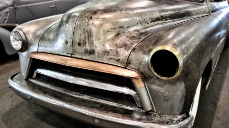 junk: vintage car abandoned and rusting away
