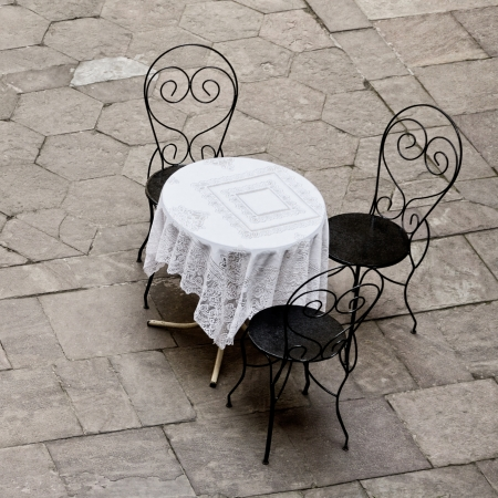 round chairs: street cafe round table and three chairs Stock Photo