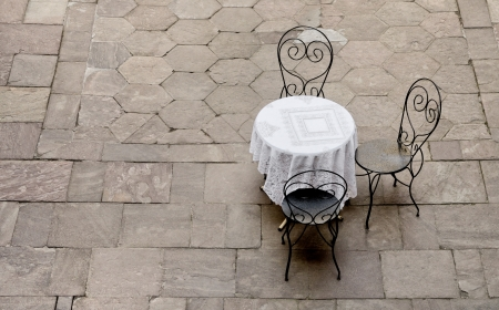 round chairs: street café in Europe Stock Photo