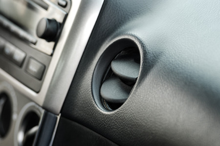 air vent in small middle class  car, interior photo