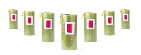 Seven green candles stand in v-like structure Zdjęcie Seryjne