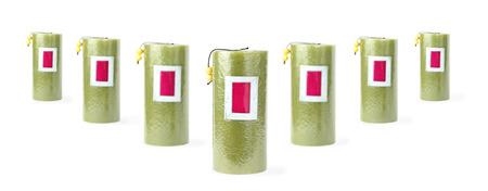 Zeven groene kaarsen staan ??in v-achtige structuur Stockfoto