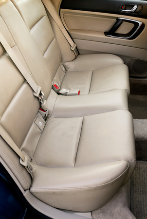 Leather back car seats in warm sunset light Imagens