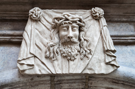 stone carving: Face sculpture of Jesus Ð¡hrist, close-up on 19 century building facade
