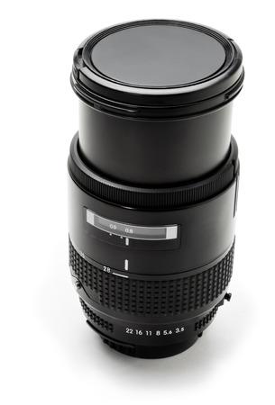 Black camera lens on a white background