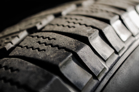grooves: Car tire close-up, texture and patters on tire surface