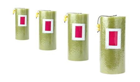 4 green candles stand in a row
