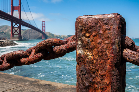 west gate: Rusted chain fence in harbor near Golden Gate Bridge