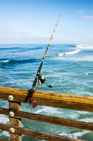 fishhook: Fishing rod on the pier, close up