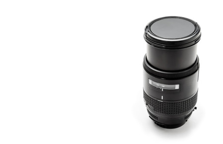 negative space: Modern telephoto Dslr lens with negative space, close-up, isolated on white,altered, no trademarks