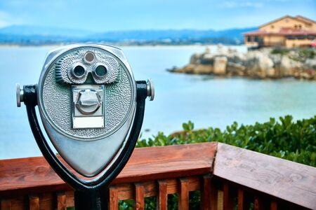 Observation deck with binoculars looking at the bay and seashore Banque d'images