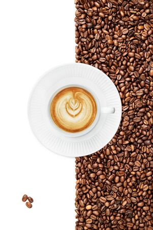 Cup of a Late tilted right on a white plate suraunded by coffee beans on the white background 3 roasted coffee beans isolated in the left bottom corner on the white backround Stock fotó