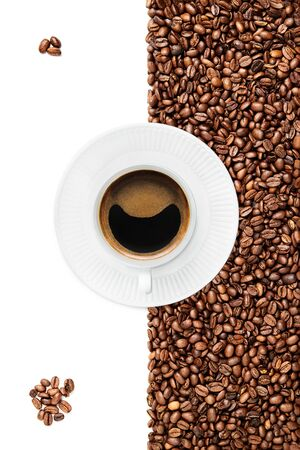 Cup of black coffee with some foam tilted down on a white plate suraunded by coffee beans on the white background 3 coffee beans left top corner, and some on the bottom Stock fotó