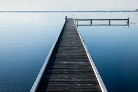 jetty at Lake Macquarie with slight fog in the distance Фото со стока - 90358988