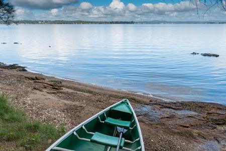 Green Canoe on Lake shore