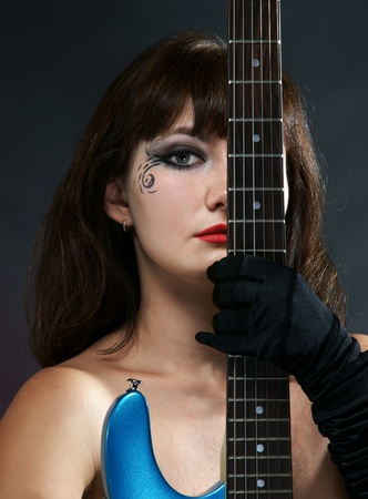 The naked girl with a guitar Stock Photo - 13298209