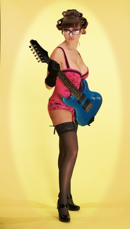 Pin-Ap the girl with a guitar Stock Photo - 13297882