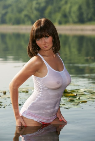 The sexual girl in a wet vest