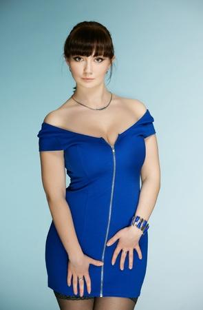 The beautiful brunette in a dark blue dress Stock Photo - 13298041
