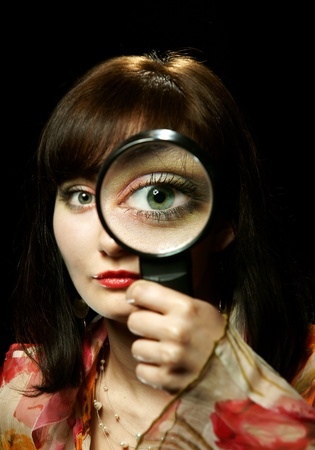 The girl with a magnifier