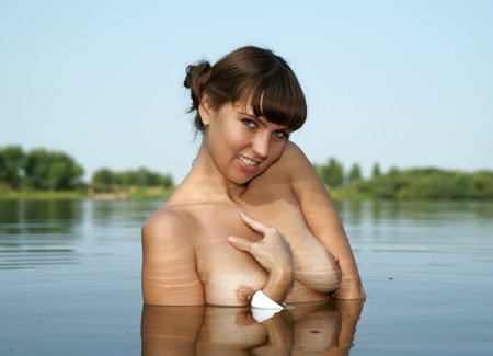 The bared girl bathes in lake
