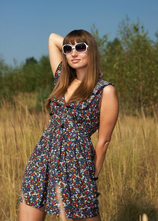 The beautiful girl in the field Stock Photo - 13298292