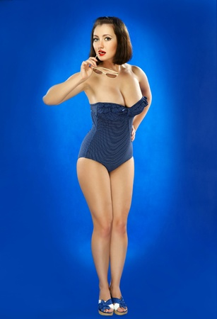 bathing   suit: The girl in a bathing suit on a dark blue background
