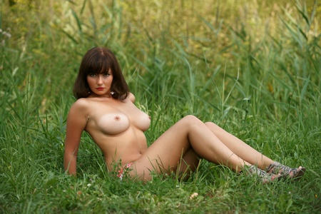 The beautiful girl on a green grass Stock Photo - 13328984