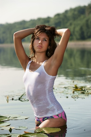 The sexual girl in a wet vest Stock Photo - 13335439