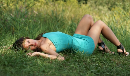 The beautiful girl on a green grass Stock Photo - 13335727