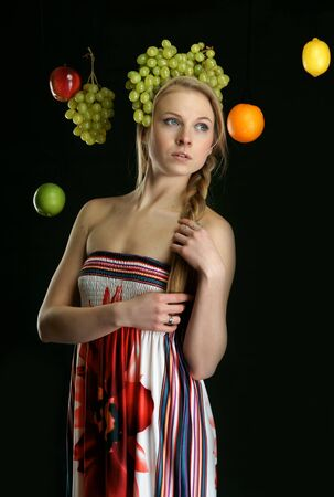 The beautiful girl with fruit Stock Photo - 13340807